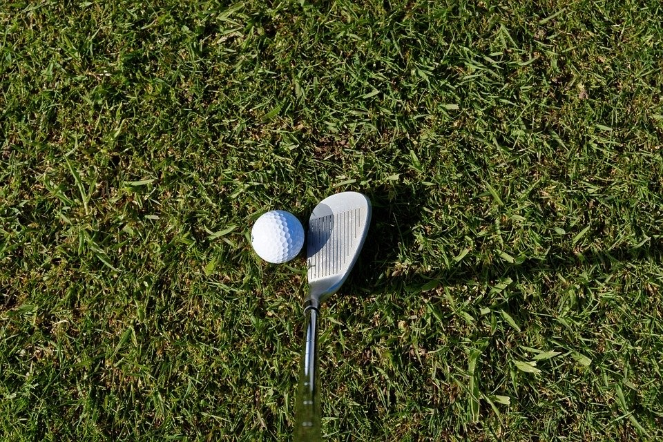 A golf ball and a wedge